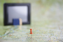 Map and gps. Destination on a card and GPS receiver in a blur background Stock Photography