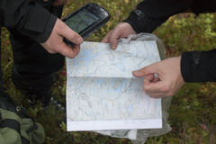 Map GPS hands. Map and gps held in hands Royalty Free Stock Photography