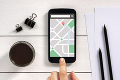 Map gps navigation application on smart phone screen with office Stock Images