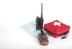 Map, gps navigator, portable radio and first aid kit on a light Stock Photo