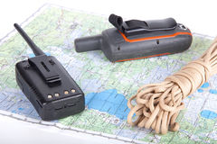 Map, gps navigator and portable radio on a light background. Set Royalty Free Stock Photography