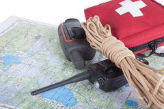 Map, gps navigator, portable radio, rope and first aid kit on a Royalty Free Stock Image