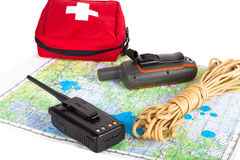 Map, gps navigator, portable radio, rope and first aid kit on a Stock Photography