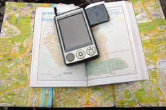 Map Guide and Pocket PC with GPS. Map Guide & Pocket PC with GPS Stock Images