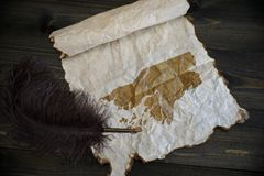 Map of guinea bissau on vintage paper with old pen on the wooden texture desk. Background stock photography