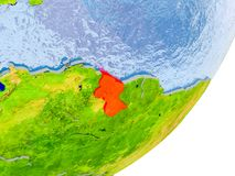 Map of Guyana on Earth. 3D render of Guyana on political globe with embossed countries with real land surface and water in place of ocean. 3D illustration Royalty Free Stock Photo