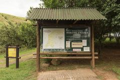 Map of hiking trails at the Mahai camp site. ROYAL NATAL NATIONAL PARK, SOUTH AFRICA - MARCH 14, 2018: A map of hiking trails and a mountain register at the stock photos
