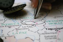 Pen pointing on a map a Honduras City Comayagua stock images