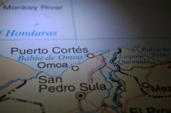 Ligth ilumination on a map a Honduras City Puerto Cortes stock photo