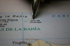 Pen pointing on a map a Honduras Island Guanaja royalty free stock photo