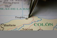 Pen pointing on a map a Honduras City Trujillo. Map of Honduras marked and a pen pointing to the city Trujillo royalty free stock image