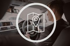 Map icon against man driving photo Royalty Free Stock Photography
