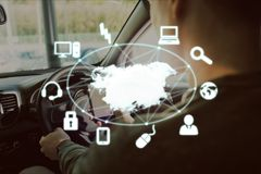 Map with icons against man in the car Royalty Free Stock Photos