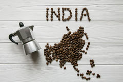 Map of the India made of roasted coffee beanMap of the Asia made of roasted coffee bes laying on white wooden textured background. Map of the India made of Stock Photos