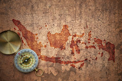 Map of indonesia on a old vintage crack paper. Background with compass royalty free stock image