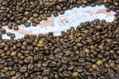 Map of Indonesia under a background of coffee beans. Geographical map of Indonesia covered by a background of roasted coffee beans. This nation is between the stock image