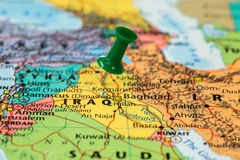 Map of Iraq with a green pushpin stuck Royalty Free Stock Photos