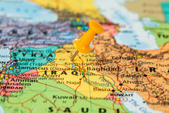 Map of Iraq with a orange pushpin stuck Royalty Free Stock Images