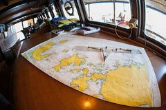 Map of Islands in Komodo National Park. A map of the islands within Komodo National Park, Indonesia, is spread in a ship`s wheelhouse. This region, part of the stock photography