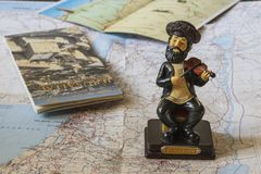 Map of Israel, a figure playing the violin of a Jew and a guide to the country. Souvenirs and maps Stock Photos