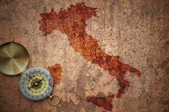 Map of italy on a old vintage crack paper. Background with compass Stock Images