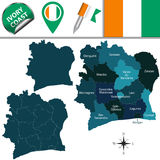Map of Ivory Coast. Vector map of Ivory Coast with named districts and travel icons Royalty Free Stock Images