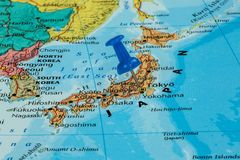 Map of Japan. With a green pushpin stuck royalty free stock photography
