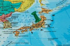 Map of Japan. With a green pushpin stuck royalty free stock image