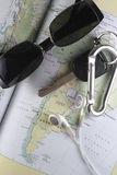 Map, Key, Sunglass and Ear Buds Stock Photography