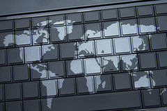 Map on keyboard. Outline map overlaid onto laptop keyboard Stock Images