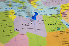 Map of Libya with a blue pushpin stuck Stock Photography