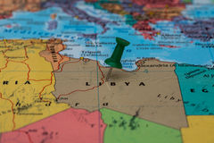 Map of Libya with a green pushpin stuck Stock Images