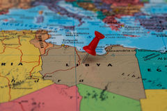 Map of  Libya with a red pushpin stuck Royalty Free Stock Photo
