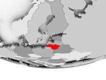 Map of Lithuania on grey political globe. Lithuania in red on grey political globe. 3D illustration Stock Photos
