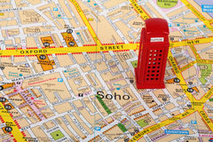 Map of London. Small model of a red phone box  on top of a map of London Royalty Free Stock Image