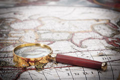 Map with Magnifying Glass Stock Images