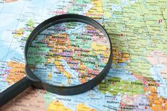Map and magnifying glass. stock photo