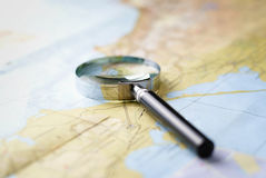 Map with a magnifying glass Royalty Free Stock Photography