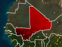Map of Mali at night. Mali highlighted in red from Earth's orbit at night with visible country borders. 3D illustration. Elements of this image furnished by Royalty Free Stock Photography