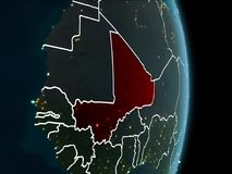 Orbit view of Mali at night. Map of Mali in red as seen from space on planet Earth at night with white borderlines and city lights. 3D illustration. Elements of Stock Images