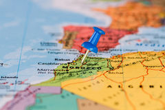 Map of Marocco with a blue pushpin stuck. Map of the state of morocco Royalty Free Stock Photo