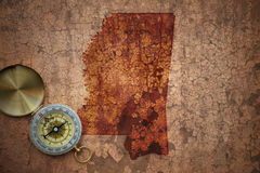 Map of mississippi state on a old vintage crack paper. Background with compass stock photos