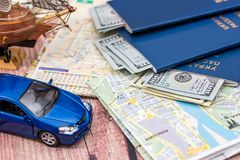 Map with money, passport and toy car. Time to travel Royalty Free Stock Images
