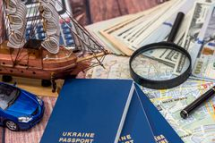 Map with money, passport and toy car. Time to travel Royalty Free Stock Image