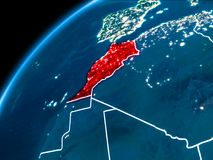 Map of Morocco at night. Morocco highlighted in red from Earth's orbit at night with visible country borders. 3D illustration. Elements of this image stock photography