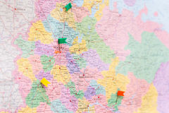 The map of Moscow is marked with pushpin. The map of Moscow is marked with a green, yellow and red pushpin Stock Image