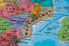 Map of Mozambique with a orange pushpin stuck Stock Photo