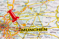Map of Munchen with stabbed pin. Map of Munchen with red stabbed pin and names of other towns in Germany Royalty Free Stock Photos