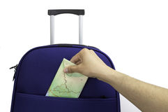 Map with my route for the holidays. Close up of a suitcase and a man keeping a map for a route on your holiday Royalty Free Stock Image