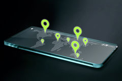 Map and navigation icons on transparent smartphone screen Stock Photos